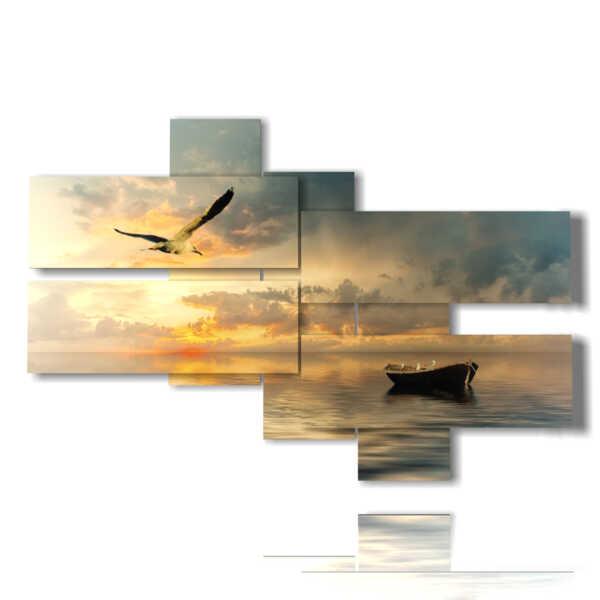 Barco cuadro de mar y gaviotas al atardecer