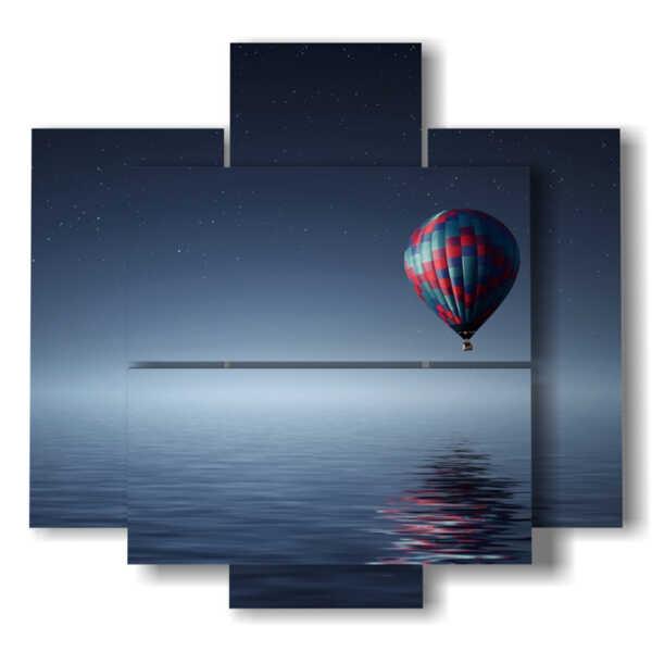 quadri con mongolfiere in una notte scaldata dalla luna