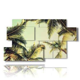 quadri con alberi in rilievo con palme da cocco nel cielo luminoso