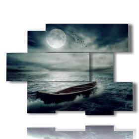 Tableau moderne avec bateau dans la mer orageuse