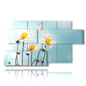 quadri con farfalle in rilievo su fiori bianchi