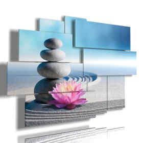 quadro con fiori viola in una coccola di sabbia e sassi