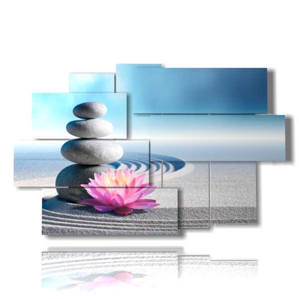 cuadro con flores de color púrpura en un abrazo de arena y piedras