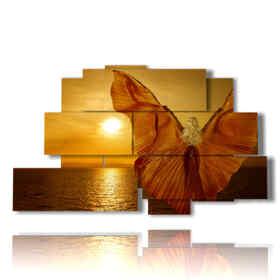 quadro con farfalle in rilievo su donna al tramonto del mare