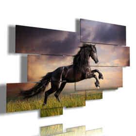 quadri stampe cavalli neri in un campo al tramonto