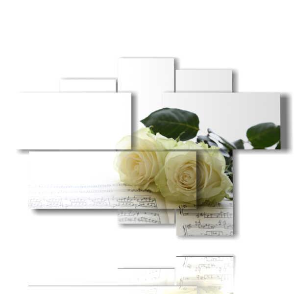 quadro rose bianche in pagine di libro