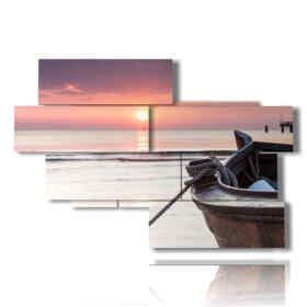cuadros con los barcos en una puesta de sol de color rosa