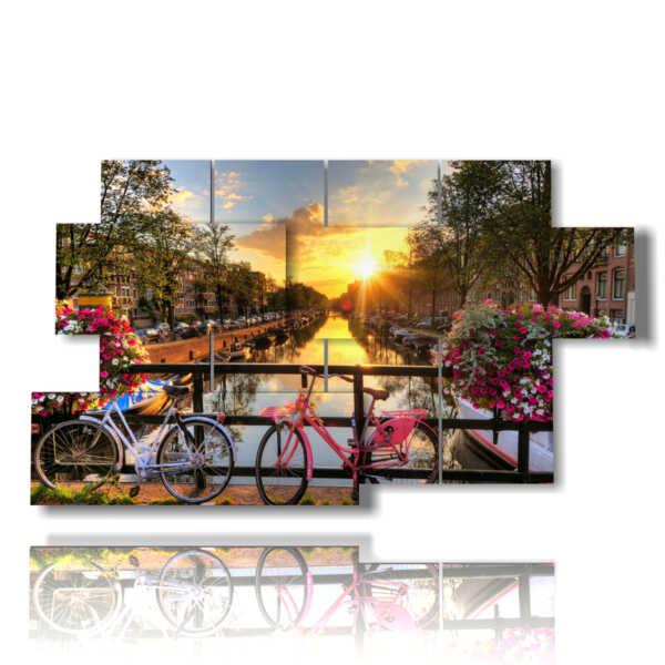 quadri amsterdam con fuori e biciclette in primavera